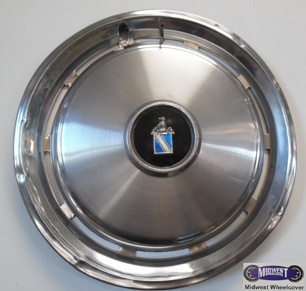 1061 hubcap 15 75 77 buick regal 10 hole type polished outer ring 10 slots raised brushed finish face black background blue and chrome logo metal clips 1061 hubcap 15 75 77 buick regal 10 hole type polished outer ring 10 slots raised brushed finish face black background blue and chrome logo metal clips